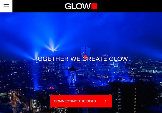 Screen capture from GLOW light art festival website showing blue light dome above the city